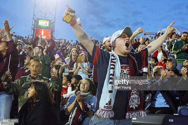 Fans of the Colorado Rapids celebrate during the Colorado Rapids v the Chicago Fire on July 4, 2009 at Dicks Sporting Goods Park in Commerce City,...
