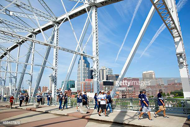 Fans of the Dallas Cowboys and the Tennessee Titans walk to the game with downtown Nashville in the background at LP Field on September 14 2014 in...