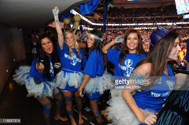 Fans of the Dallas Mavericks cheer before Game Four of the NBA finals against the Miami Heat at the AmericanAirlines Center in Dallas on June 7 2011...