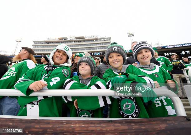 Fans of the Dallas Stars show their support during the 2020 NHL Winter Classic between the Nashville Predators and the Dallas Stars at Cotton Bowl on...