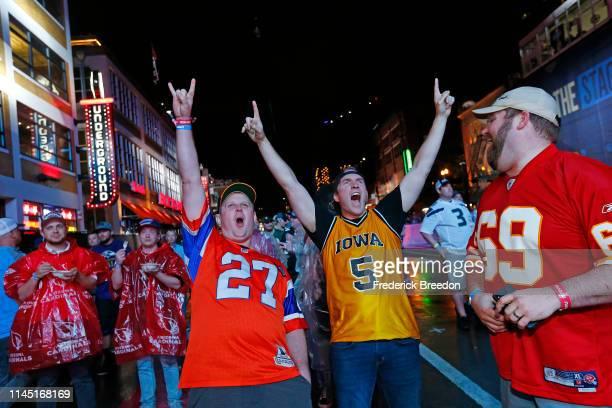 Fans of the Denver Broncos react after Denver Broncos draft Noah Fant on day 1 of the 2019 NFL Draft on April 25 2019 in Nashville Tennessee