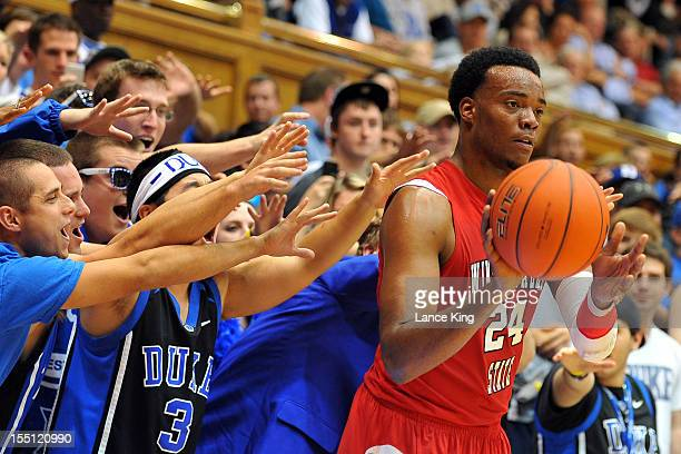 Fans of the Duke Blue Devils try to distract Kimani Hunt of the WinstonSalem State Rams at Cameron Indoor Stadium on November 1 2012 in Durham North...