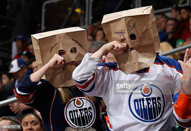 Fans of the Edmonton Oilers wearing bags on their heads react during the NHL game against the Arizona Coyotes at Gila River Arena on December 16 2014...