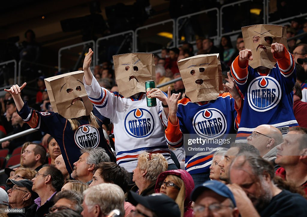 Fans of the Edmonton Oilers wearing bags on their heads react during the NHL game against the Arizona Coyotes at Gila River Arena on December 16, 2014 in Glendale, Arizona. The Coyotes defeated the Oilers 2-1 in an overtime shootout.