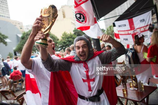 Fans of the England football team gather in a bar ahead of the England's match against Uruguay on June 19 2014 in Sao Paulo Brazil England are...