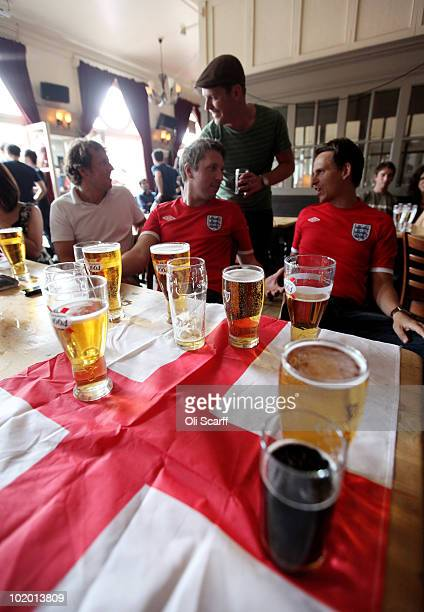 Fans of the England football team gather in Clapham as England prepare to begin their first game of the FIFA World Cup in South Africa on June 12...