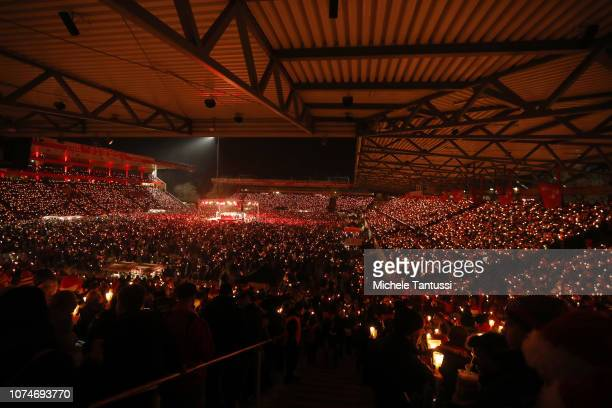 Fans of the FC Union football club gather in the club's stadium to sing Christmas carols on December 23, 2018 in Berlin, Germany. The annual...