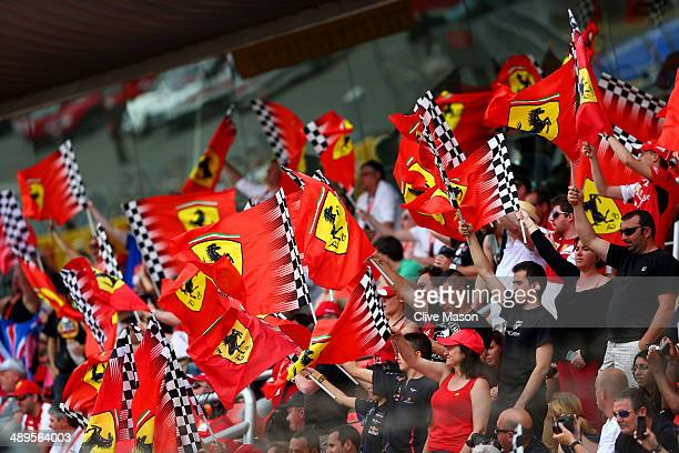 Fans of the Ferrari team wave flags in the grandstand during the Spanish Formula One Grand Prix at Circuit de Catalunya on May 11 2014 in Montmelo...