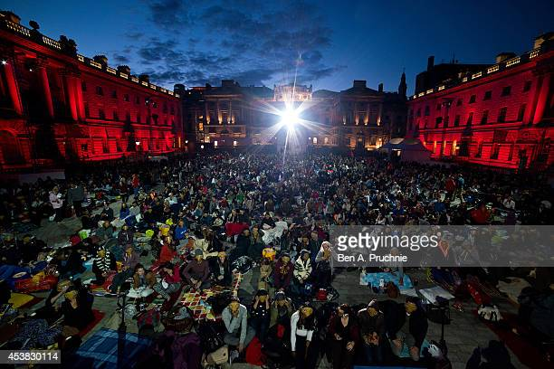 """Fans of the film """"ET: The Extra Terrestrial"""" take party in a photocall ahead of the Film4 screening at Somerset House on August 19, 2014 in London,..."""