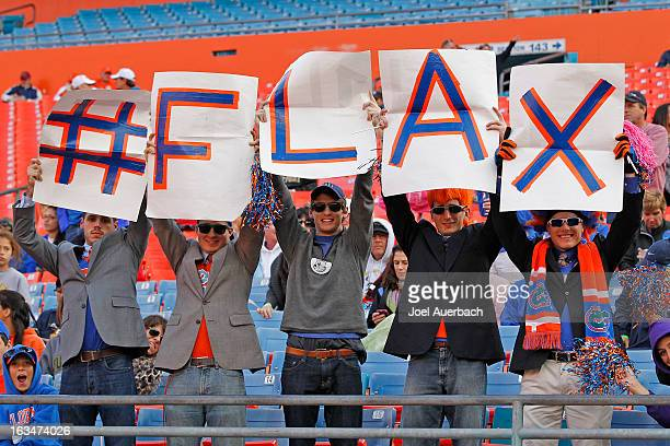 Fans of the Florida Gators hold up a sign with a Twitter hashtag prior to the game against the Syracuse Orange during the 2013 Orange Bowl Lacrosse...