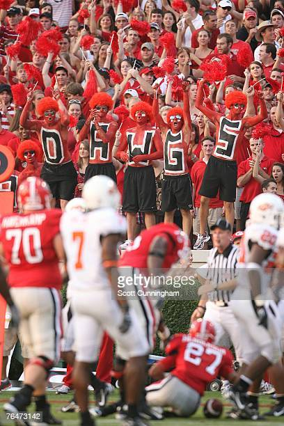 Fans of the Georgia Bulldogs celebrate a touchdown against the Oklahoma State Cowboys at Sanford Stadium on September 1 2007 in Athens Georgia...