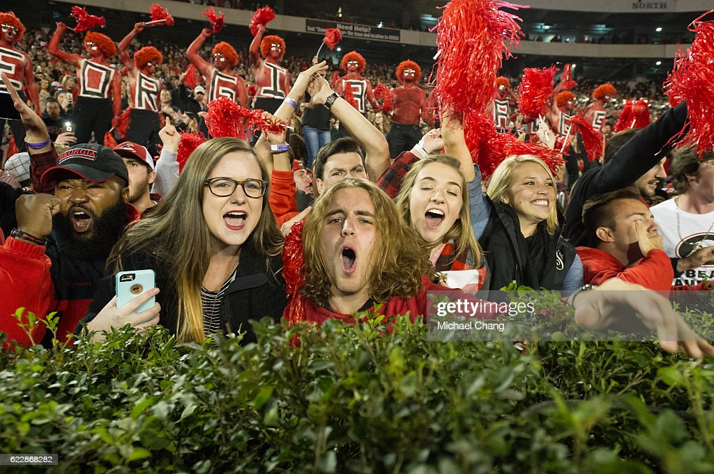 Fans of the Georgia Bulldogs celebrate after defeating the Auburn Tigers at Sanford Stadium on November 12, 2016 in Athens, Georgia. The Georgia Bulldogs defeated the Auburn Tigers 13-7.