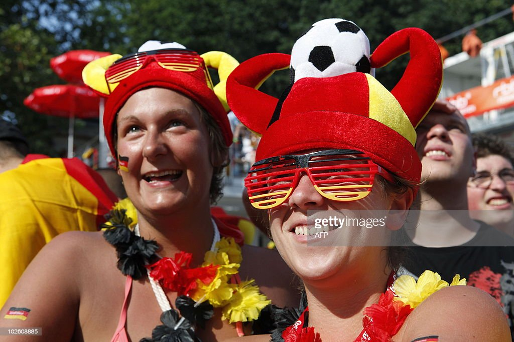 Fans of the German national football team follow the action during the public viewing at the 'Fanmeile' (Fan Mile) in Berlin on July 3, 2010, of the FIFA World Cup quarter-final match opposing Argentina to Germany in Cape Town, South Africa. Germany won the match 0-4 and have made it to the semi-finals.