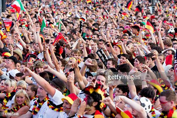 Fans of the German team react before the start of the UEFA Euro 2012 championships semi-final football match between Germany and Italy at the...
