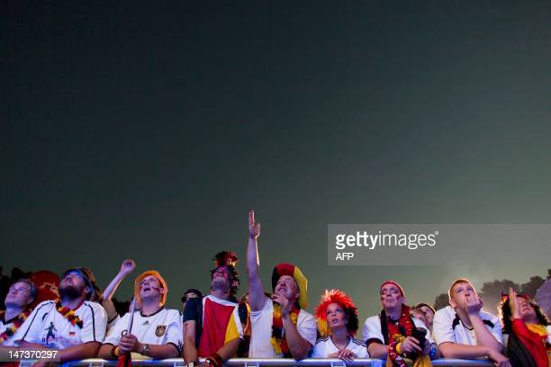 Fans of the German team react during the UEFA Euro 2012 championships semi-final football match between Germany and Italy at the socalled Fanmeile...