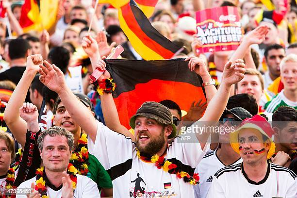 Fans of the German team wait before the start of the UEFA Euro 2012 championships semi-final football match between Germany and Italy at the socalled...