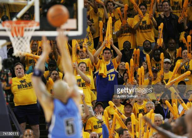 Fans of the Golden State Warriors celebrate against the Utah Jazz in Game Three of the Western Conference Semifinals during the 2007 NBA Playoffs at...