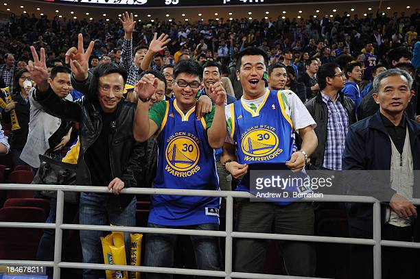 Fans of the Golden State Warriors cheers against the Los Angeles Lakers during the 2013 Global Games on October 15 2013 at the MasterCard Center in...