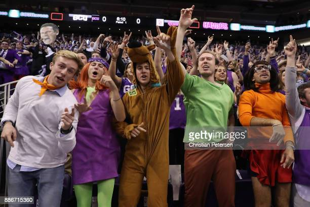 Fans of the Grand Canyon Antelopes dressed as charactors from scooby doo cheer during the first half of the college basketball game against the St...