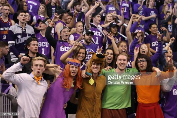 Fans of the Grand Canyon Antelopes dressed as charactors from 'scooby doo' cheer during the first half of the college basketball game against the St...