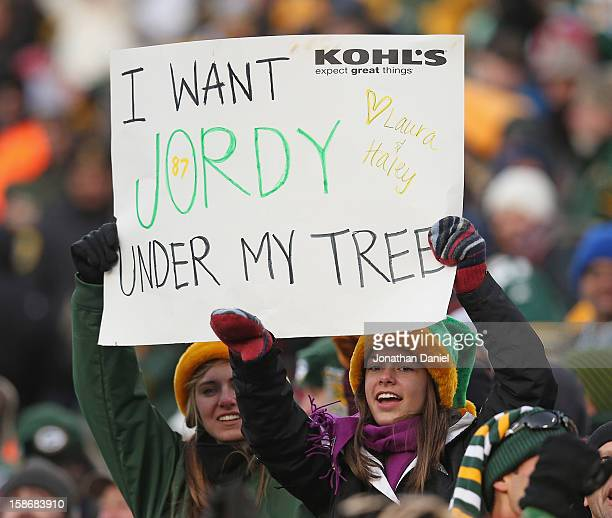 Fans of the Green Bay Packers hold a sign during a game against the Tennessee Titans at Lambeau Field on December 23 2012 in Green Bay Wisconsin The...