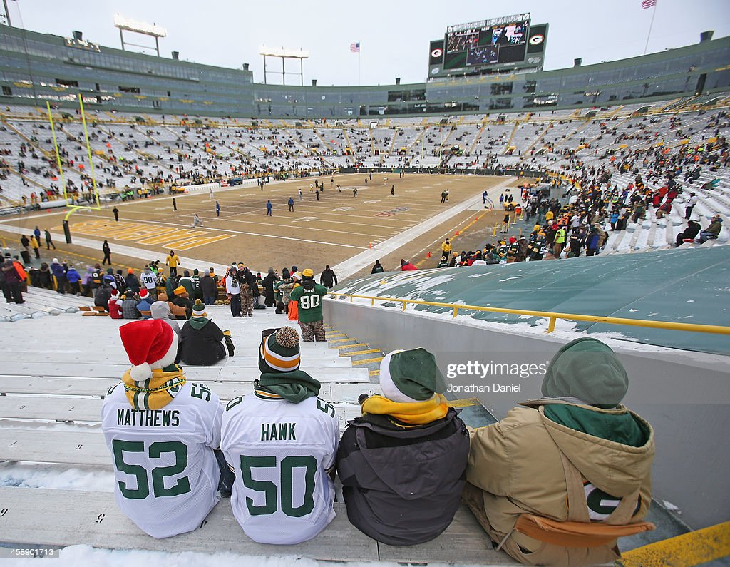 Fans of the Green Bay Packers watch a game on the view screen as players come out for warm-ups before a game between the Packers and the Pittsburgh Steelers at Lambeau Field on December 22, 2013 in Green Bay, Wisconsin.