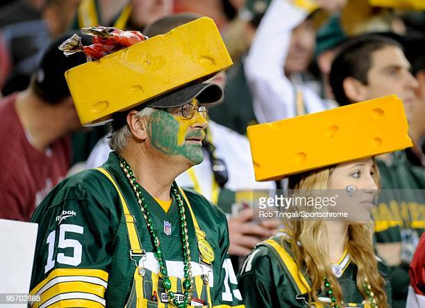 Fans of the Green Bay Packers with cheese heads look on against the Arizona Cardinals in the NFC wild-card playoff game at University of Phoenix...