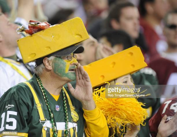 Fans of the Green Bay Packers with cheese heads look on against the Arizona Cardinals in the NFC wildcard playoff game at University of Phoenix...