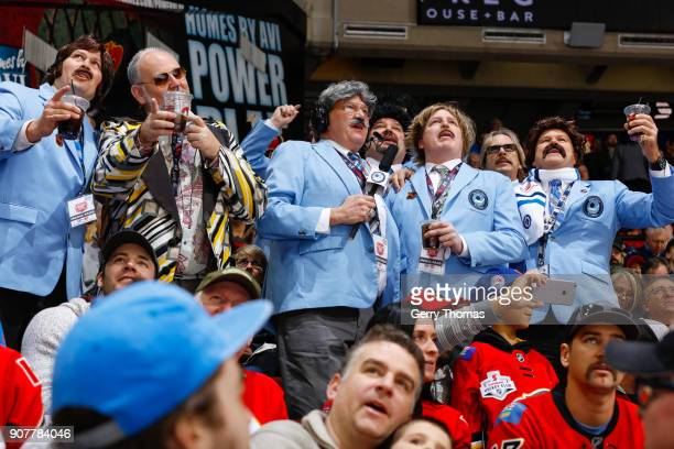 Fans of the Hockey Night in Canada show dress in retro outfits in an NHL game on January 20 2018 at the Scotiabank Saddledome in Calgary Alberta...
