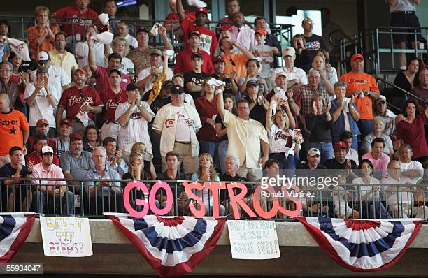 Fans of the Houston Astros cheer after Jason Lane hit a solo home run during Game Four of the National League Championship Series against the St...