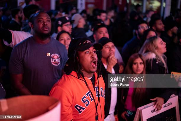 Fans of the Houston Astros react to losing the lead to the Washington Nationals in game 7 of The World Series October 30, 2019 in Houston, Texas....
