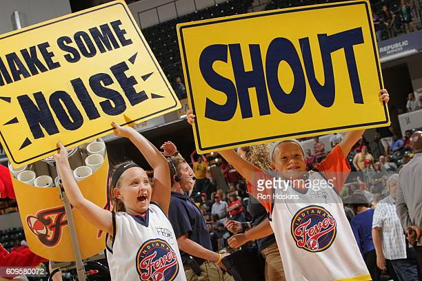 Fans of the Indiana Fever cheer during the game against the Minnesota Lynx on September 16, 2016 at Bankers Life Fieldhouse in Indianapolis, Indiana....