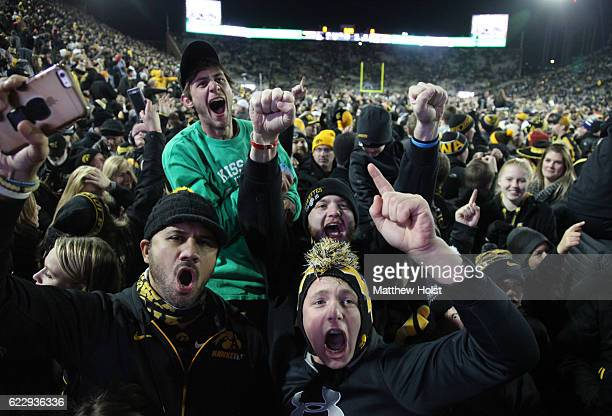 Fans of the Iowa Hawkeyes celebrate on the field after the upset against the Michigan Wolverines on November 12 2016 at Kinnick Stadium in Iowa City...