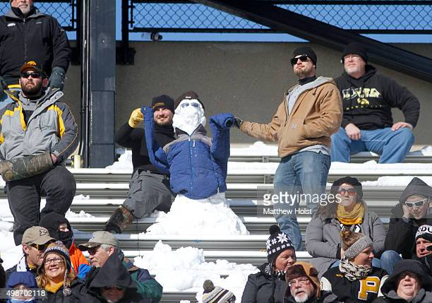 Fans of the Iowa Hawkeyes help their snowman cheer in the first half against the Purdue Boilermakers on November 21 2015 at Kinnick Stadium in Iowa...