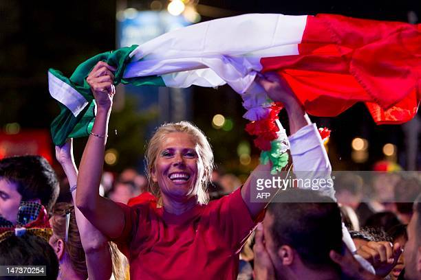 Fans of the Italian team celebrate at the end of the UEFA Euro 2012 championships semi-final football match between Germany and Italy at the socalled...