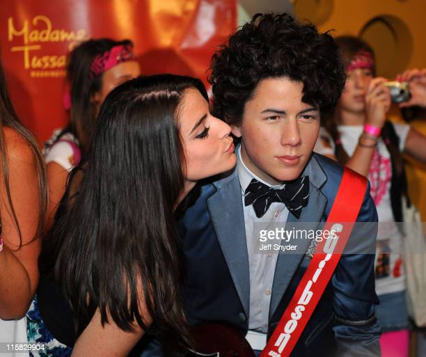 Fans of the Jonas Brothers attend the unveiling of Jonas Brothers wax figures at Madame Tussauds on August 18 2008 in Washington DC
