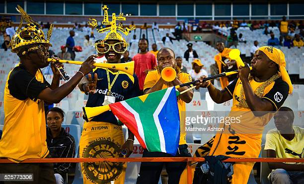Fans of the Kaizer Chiefs wearing a makarapa a customised miner's hard hat / fan helmet and a pair of glasses with flags
