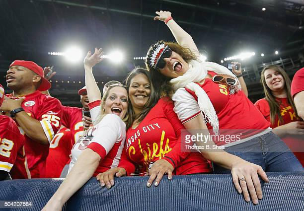 Fans of the Kansas City Chiefs celebrate in the fourth quarter against the Houston Texans during the AFC Wild Card Playoff game at NRG Stadium on...