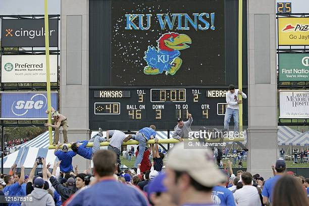 Fans of the Kansas Jayhawks tear down the goal post following a win over the Nebraska Cornhuskers at Memorial Stadium in Lawrence Kansas on November...