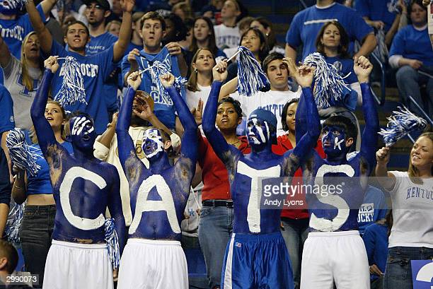 Fans of the Kentucky Wildcats show their support for their team during the game against the Louisville Cardinals on December 27 2003 at Rupp Arena in...