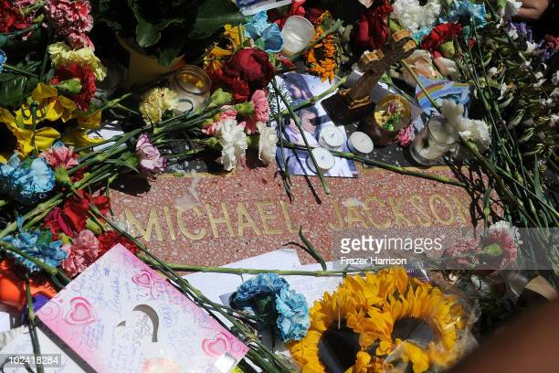 Fans of the late pop star Michael Jackson pay tribute at his star on the Hollywood Walk of Fame to commemorate the first anniversary of his death