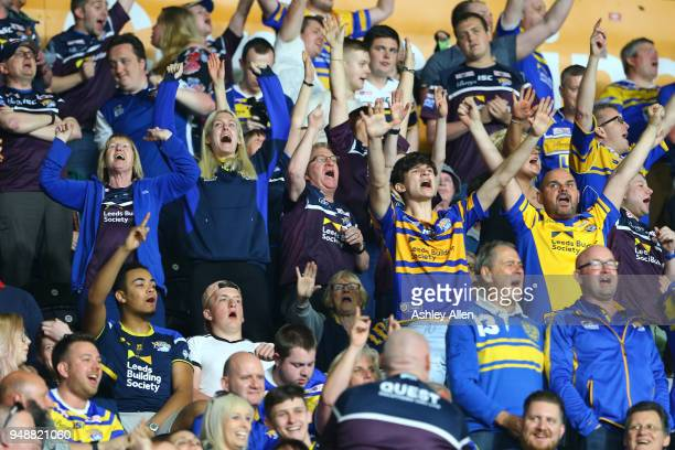 Fans of the Leeds Rhinos cheer during the BetFred Super League match between Hull FC and Leeds Rhinos at the KCOM Stadium on April 19 2018 in Hull...