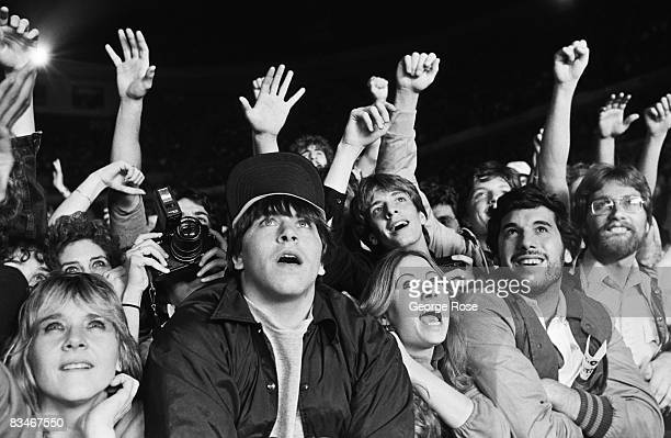 Fans of the legendary rock group The Who crowd the stage during the bands' 1982 New York New York farewell concert at Shea Stadium
