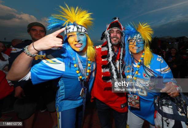 Fans of the Los Angeles Chargers pose for photos before the game against the Kansas City Chiefs at Estadio Azteca on November 18 2019 in Mexico City...