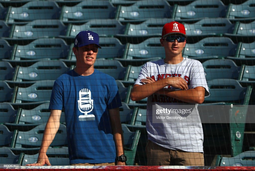 Fans of the Los Angeles Dodgers and the Los Angeles Angels of Anaheim watch batting practice prior to the MLB game at Angel Stadium on July 6, 2018 in Anaheim, California.