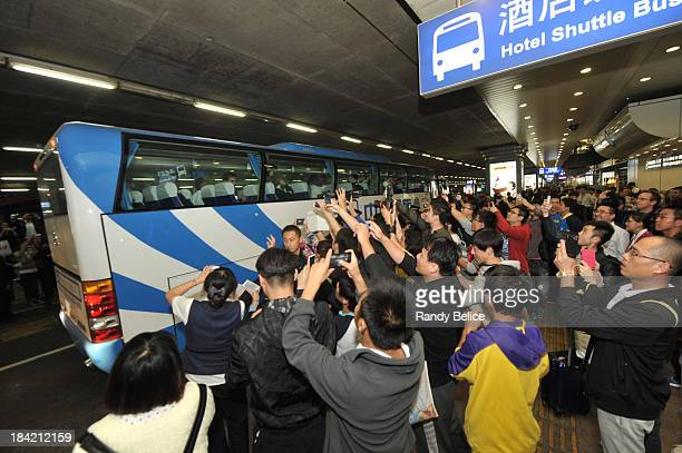 Fans of the Los Angeles Lakers cheers for the team at Beijing Capital International Airport on October 12 2013 as part of the 2013 NBA Global Games...