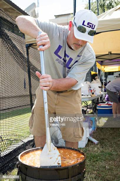 Fans of the LSU Tigers cook up some gumbo in a big pot before a game against the Auburn Tigers at Tiger Stadium on October 14 2017 in Baton Rouge...