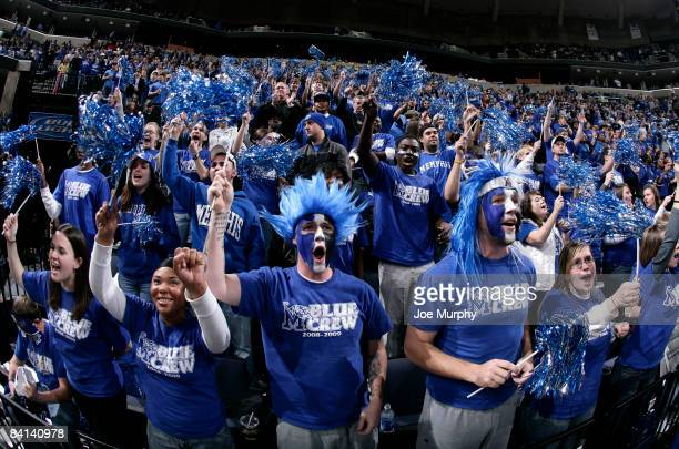 """Fans of the Memphis Tigers known as the """"Blue Crew"""" cheer during a game against the Cincinnati Bearcats at FedExForum on December 29, 2008 in..."""
