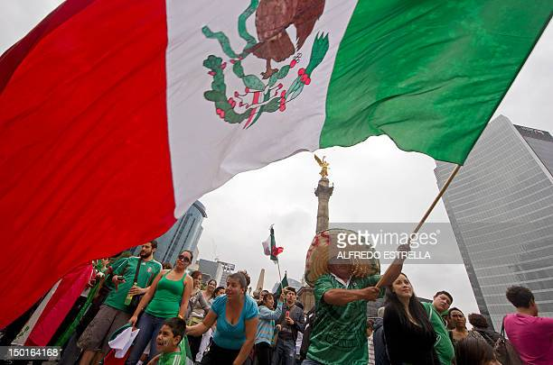 Fans of the Mexican Olympic team celebrate after Mexico won the Gold in the London 2012 Olympic Games Men's football event at the Independence...