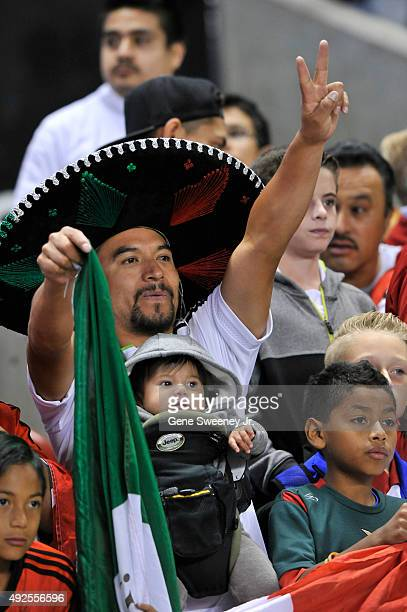 Fans of the Mexican team celebrate the 20 win by Mexico over Honduras to take the championship in the final CONCACAF Olympic Qualifying match at Rio...